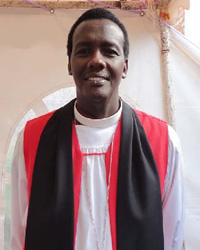 The Bishop of Kigali Diocese Rt. Rev. Louis Muvunyi